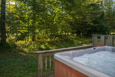 Enjoy the view of the stream while soaking in the hot tub