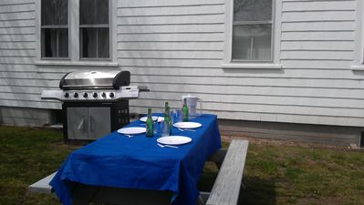 Gas grill with side burner & sear grate, a joy to cook outdoors. Set the table!