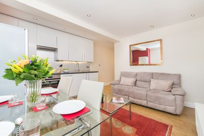 Comfy leather sofa, dining table and fully equipped kitchen