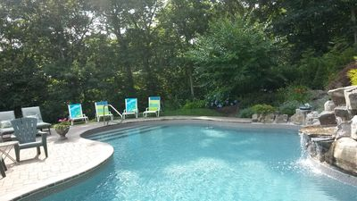 Relax near or in serene Salt Water Pool with Waterfall