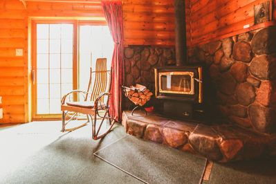 The living room features a woodburning fireplace