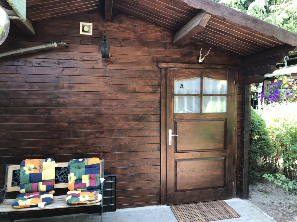 Cozy log cabin next to the koi pond in the vrbo for Koi pool and sauna