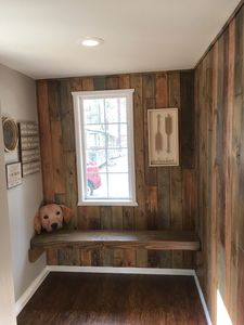 Mud room with bench to put your snow boots on and hooks to hang all of your gear