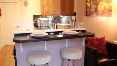 Breakfast bar and comfortable leather stools in Rose's Rest
