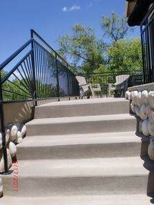 Come on up the easy rise stairs to the front door and lounging BBQ area