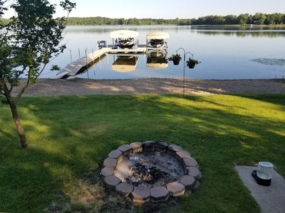 Beautiful level lake view with boat access on site.