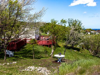 Photo for Cozy rural duplex has a large patio with an ocean view & established bird feeder