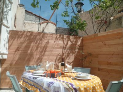 Photo for Sunny terrace, close to metro, bus, beach and city center fast