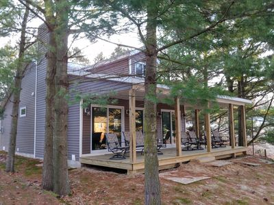 Wrap around covered porch facing the lake.
