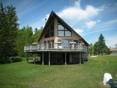 Photo for 3BR/2BA Lakefront Cabin, Gorgeous Bay Views, Dock, Game Room, Firepit
