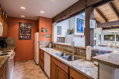 Brand new kitchen remodel with new appliances, granite counter tops, and tile floor