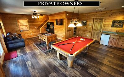 Game room with pool table, multi-cade and foosball.