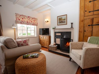 A warm inviting lounge to cosy up in front of the fire