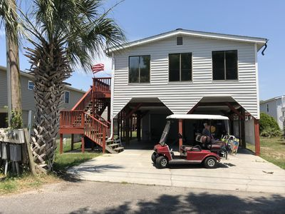 Golf Cart & Private Beach Parking included.  Sleeps 6