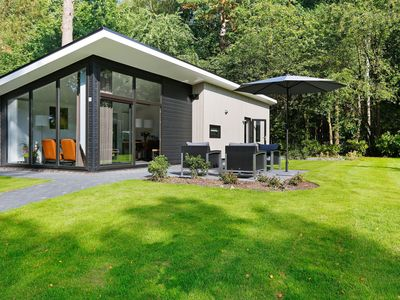 Photo for Modern designed chalet with a smart TV, next to the forest