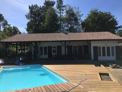 Photo for Charming villa, heated pool, quiet wooded land, near lake, ocean, forests