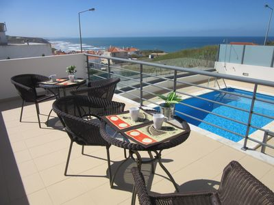 "Terrace with tables and chairs and a view toward the sea ""Casas da Arriba N5"""