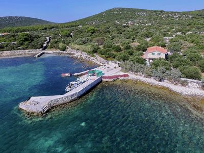 Photo for Cozy fisherman's cottage right on a bay on the Croatian island of Pasman