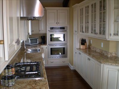 Beautiful designer kitchen with stainless appliances