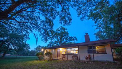BEAUTIFUL RETREAT HOME ON 4 ACRES WALK TO THE FOREST!! CLOSE TO GOLF COURSES!