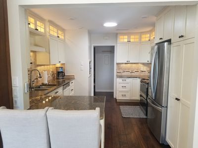 Fully renovated high-end beachfront penthouse unit with heated pool!