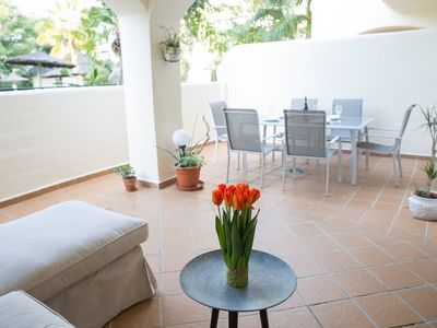 Photo for Two sunny terraces ground floor apartment. A perfect holiday home for families!