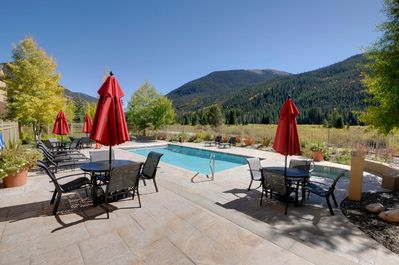 Heated outdoor pool with two hot tubs; view of the mountains and river wetlands