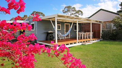 Large fully fenced secure garden with large deck for entertaining.