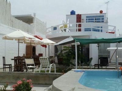 Photo for Beautiful and large beachfront house with pool - First Floor