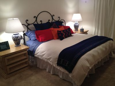 Master Bedroom with cozy down comforter, pillows and high thread count sheets