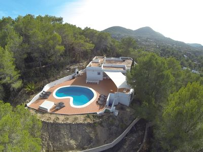 Photo for Villa on top of hill surrounded by pine trees, beautiful sea view, private pool,