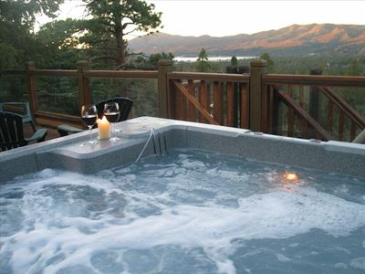Large hot tub on the top level deck with panoramic view of the mountains & lake