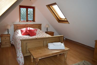 Light and airy yet cosy bedroom with king size bed