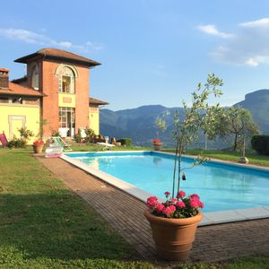 Photo for Splendid Liberty villa overlooking the lush green Tuscan valleys and mountains