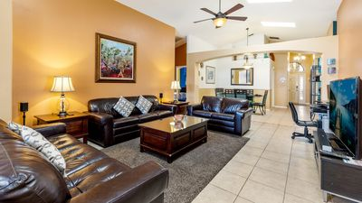 The living room has been recently updated with new leather furniture.