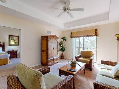 Photo for 5th floor condo w/ shared pools, sauna, hot tub, balcony, gym, near theme parks