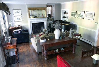 Living Room featuring gas fireplace & baby grand piano
