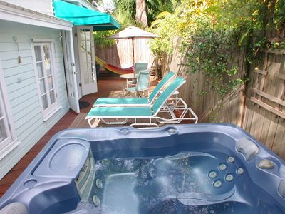 Seashell Cottage back deck,  with private spa, hammock, BBQ, lounge chairs.