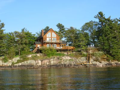 Photo for TI Swiss Miss; Channel side home with protected dock in bay behind house!