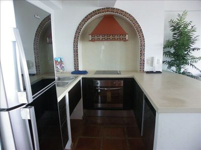 Authentic Mexican Kitchen includes modern kitchen appliances and cookware/dishes