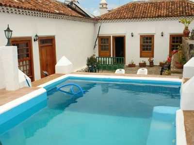 Photo for Homerez last minute deal - Beautiful house with pool access