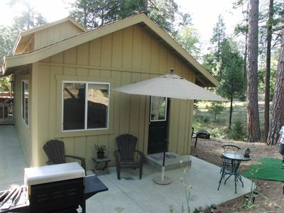 Private patio with large gas grill surrounded by National Forest.