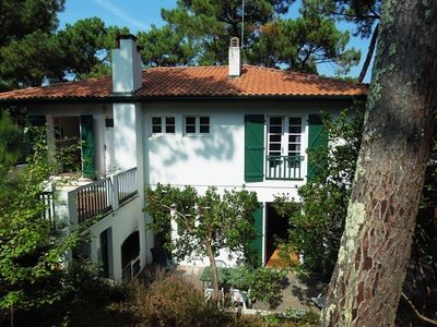 Photo for Hossegor - House from the 50's on a fenced and sloping terrain, located 300m away from the Ocean...