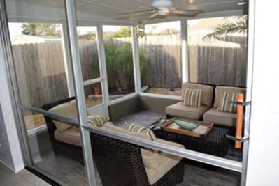 Lovely screened patio with seating.  Keep doors open most days & enjoy a breeze.