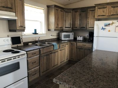 Full size stove and fridge, and  dishwasher (detergent provided),Microwave Coffee Maker and electric kettle
