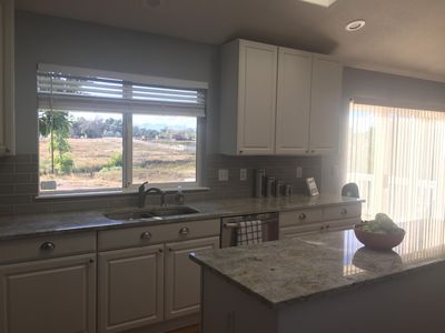Kitchen with view of open space and walking trail.