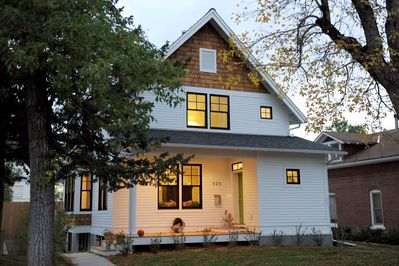 The front facade and porch where you can sit and read and greet the neighbors
