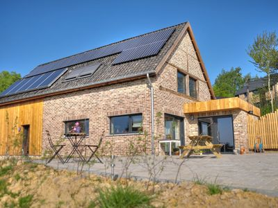 Photo for Enchanting sustainable house with view over orchard on the Dutch border
