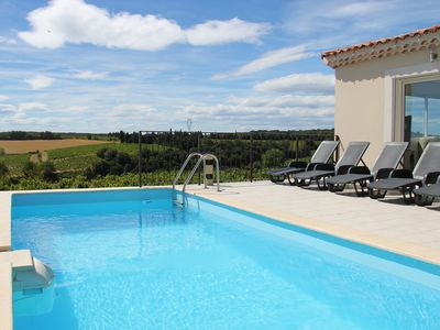Photo for Modern house with panoramic swimming pool, calm and superb view of the vineyards