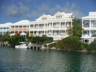 Photo for Waterfront villa with inc dock, steps from new pool and restaurant. 3b/r 3.5bath